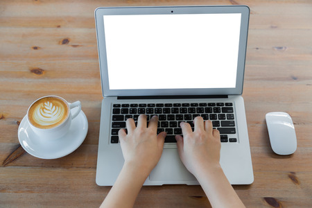 Closeup of business woman hand typing on laptop keyboard and coffee