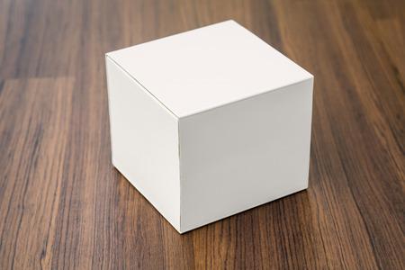 box: Blank white box mock up on wood background