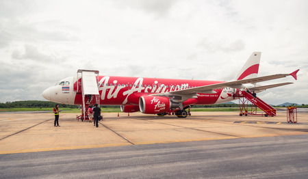 operates: LOEI, THAILAND - JULY 15, 2015: AirAsia Jet airplane in Loei airport in Loei. Its been named as worlds best low-cost airline, operates scheduled flights to 78 destinations Editorial