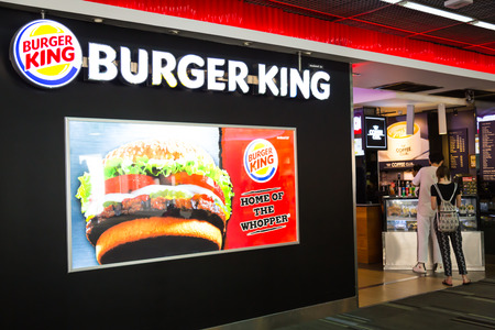 king of thailand: BANGKOK - July 19 2015: Burger King Restaurant in Don Mueang  international airport. It is the second largest fast food hamburger chain in the world. Editorial