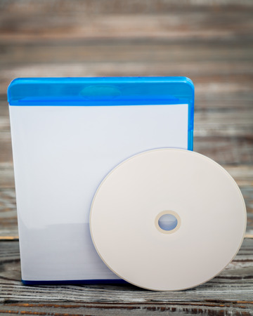 recordable: Blank compact disc with cover on wood background ground Stock Photo