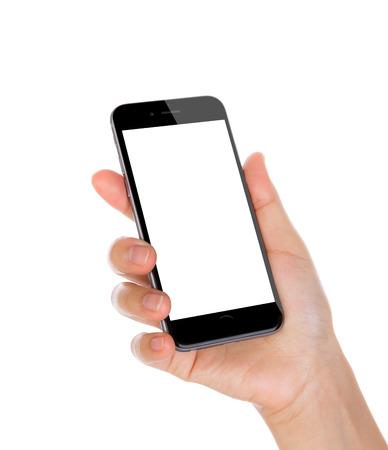 alzando la mano: Mano que sostiene teléfono móvil inteligente con pantalla en blanco aislado en fondo blanco Foto de archivo