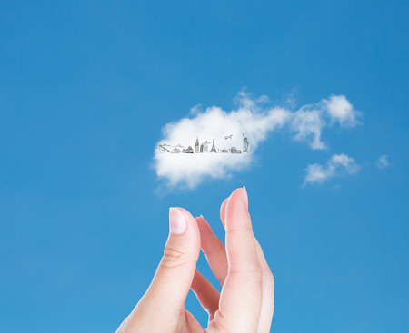 renewabel: Hand with cloud of travel  in blue sky   (Japan,France,Italy,New York,India,egypt) Stock Photo