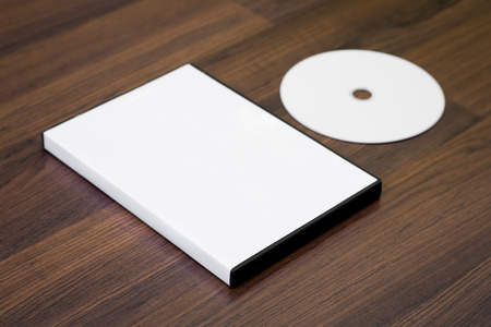 compact: Blank compact disc with cover on wood background ground Stock Photo
