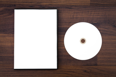 Blank compact disc with cover on wood background ground Stock Photo