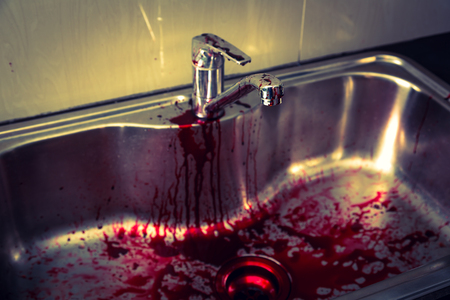 wrongdoing: Kitchen sink  with blood for halloween ( Filtered image processed vintage effect. )