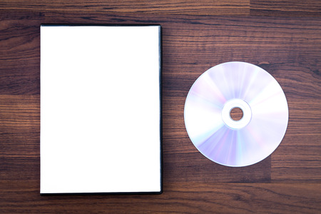 rewritable: Blank compact disc with cover on wood background ground Stock Photo