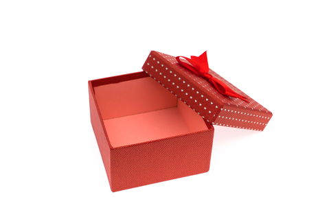 GLOD: Red gift box with red and glod ribbon on white background