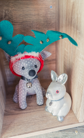 santa moose: Dog as deer doll with rabit Stock Photo