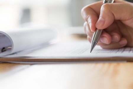 Hand with pen over application form Foto de archivo
