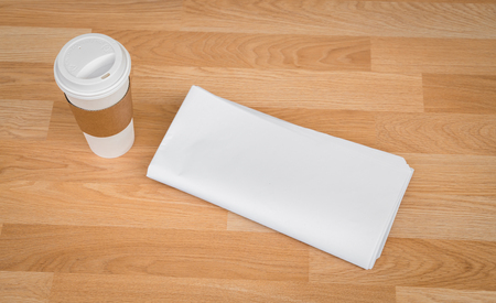 broadsheet: Blank Newspaper with empty space and coffee cup mock up on wood background
