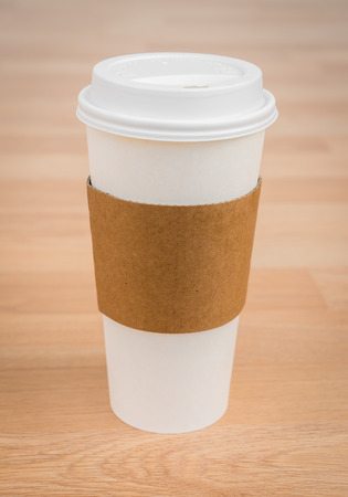white coffee: Paper cup of coffee on wood background Stock Photo
