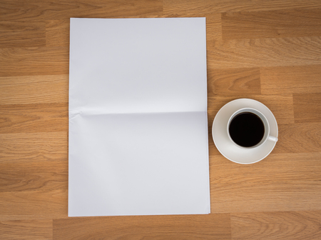 broadsheet newspaper: Blank Newspaper with empty space and coffee cup mock up on wood background