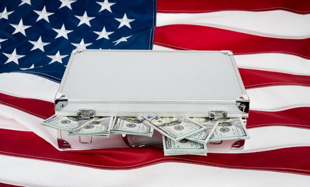 stack of dollar bill: Suitcase of money with hundred dollar on flag