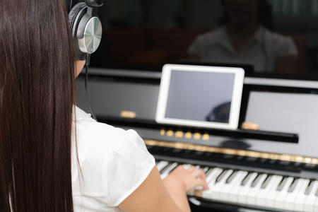 playing piano: Woman playing piano music