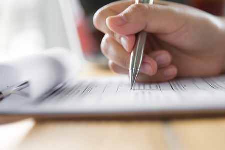 yes no: Hand with pen over application form Stock Photo