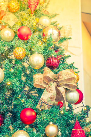 dacorated: Closeup of Christmas tree decorations background ( Filtered image processed vintage effect. )