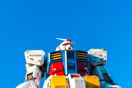 Tokyo: Full size Gundam Performances Outside DiverCity Tokyo Plaza, Odaiba, Tokyo, Japan - 27 November 2015: It is 18m tall The sculpture of famous anime franchise robot, Gundam.