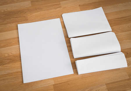 broadsheet: Blank Newspaper with empty space mock up on wood background Stock Photo