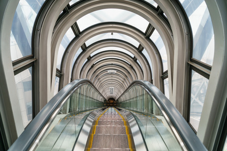 go inside: Escalator in modern building Stock Photo