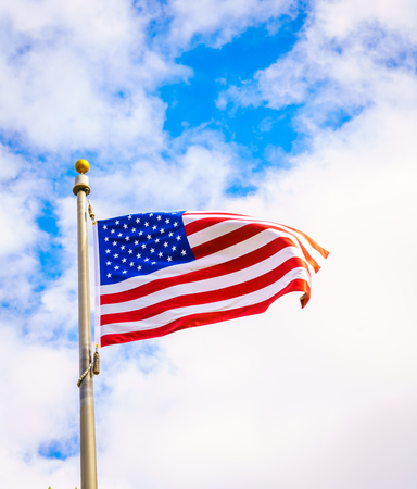 red flag up: American flag on blue sky