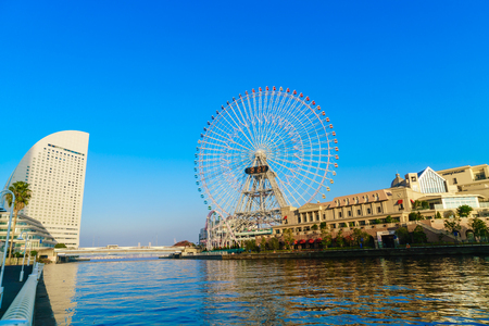 bird 's eye view: Yokohama,Japan - November 24,2015 : Ferris wheel at cosmo world fun park at minato mirai , Yokohama is the third biggest city in Japan. Editorial