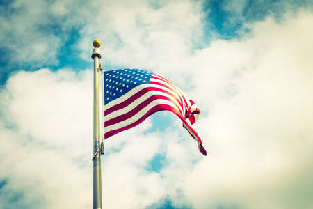 processed: American flag on blue sky ( Filtered image processed vintage effect. )