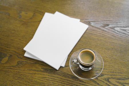 empty table: Blank catalog, magazines,book mock up on wood background with cup of coffee