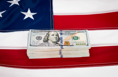 one hundred dollars: One hundred dollars banknotes on flag background