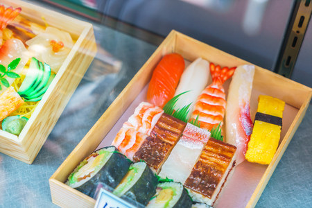 display case: Plastic Sushi rolls in a display case