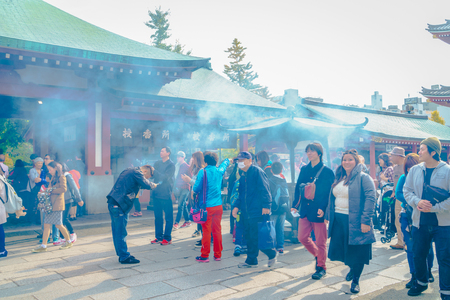 senso ji: TOKYO, JAPAN - November  24, 2015: Tourists visit to Sensoji Temple  of Asakusa, Tokyo, Japan. The temple is the oldest in all of Tokyo Editorial
