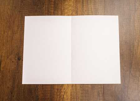 layout template: Bifold white template paper on wood texture Stock Photo