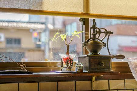 an antique: Antique coffee grinder