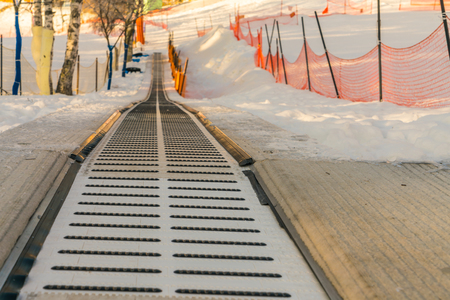 clear path: Moving walkway in snow