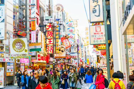 street signs: Osaka, Japan - November 30, 2015: Dotonbori entertainment district. Dotonbori is one of the principal tourist destinations in Osaka Japan.