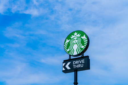 famous industries: Khonkaen Province, Thailand - December 20, 2015 : Starbucks drive thru sign at 200th store at FastFac Mini Factory one of the fastest growing industrial