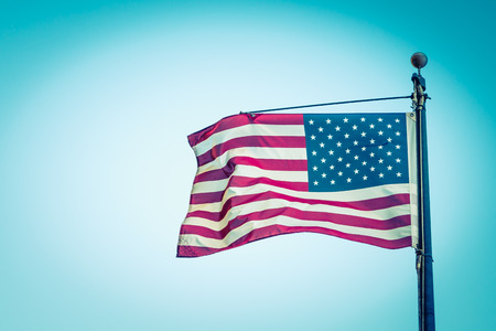 filtered: American flag on blue sky ( Filtered image processed vintage effect. )