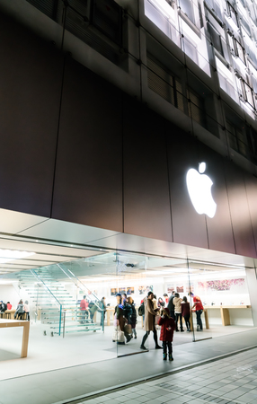 headquartered: NAGOYA, JAPAN - FEB 07, 2016: Apple Shop. Is an American corporation headquartered in Cupertino that designs and sells consumer electronics, computer software and personal computers.