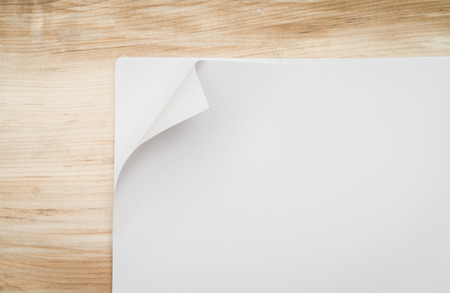 curled edges: Real Paper Corner Fold on wood background