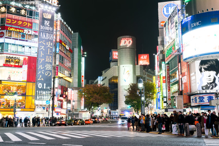 taxi famous building: Tokyo, Japan - Nov 25: Pedestrians cross at Shibuya Crossing on November 25 th in Tokyo, Japan, 2015 . Shibuya Crossing is one of the busiest crosswalks in the world.