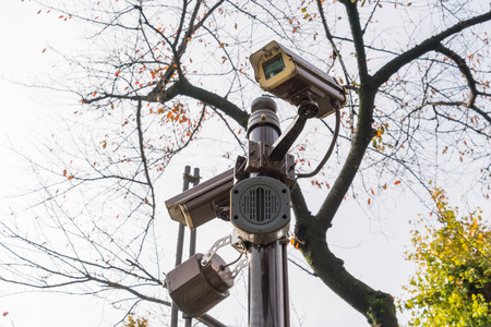 electronic survey: Close up of security surveillance camera Stock Photo