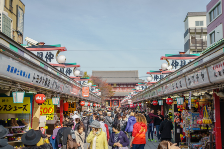 dori: TOKYO,JAPAN - 24 November  2015 :Tourists walk on Nakamise Dori in Sensoji shrine.Sensoji temple with a variety of traditional, local snacks and tourist souvenirs for centuries.