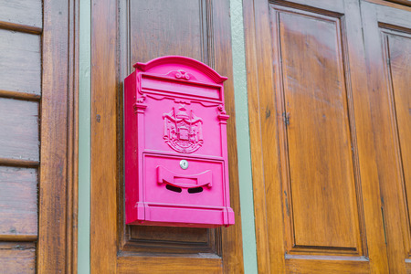 standard steel: Red mail box on wood wall