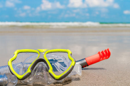 subsea: Scuba Diving Equipment On The White Sea Sand Beach Stock Photo