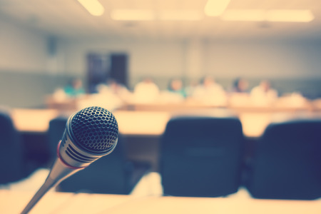 commentary: Black microphone in conference room ( Filtered image processed vintage effect. ) Stock Photo