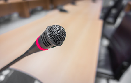 lecturing hall: Black microphone in conference room ( Filtered image processed vintage effect. ) Stock Photo
