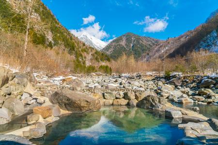 man waterfalls: Outdoor onsen ,Japan
