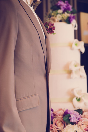young  cuffs: Closeup of  grooms boutonniere ( Filtered image processed vintage effect. ) Stock Photo