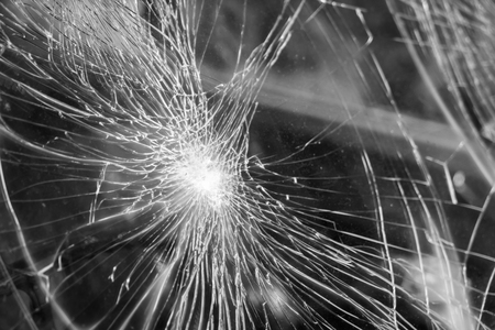 splinters: Glass broken cracks splinters in front of car