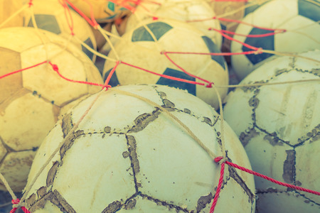 tatter: Group of Old football  ( Filtered image processed vintage effect. )